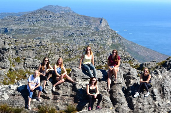 Thea Ziegler (second left) with friends on Table Mountain, overlooking Cape Town Beach.