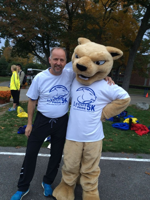 President Dennis Hanno with the Wheaton Lyon at the Lyons Pride 5K. Photo courtesy of Conner Bourgoin '16
