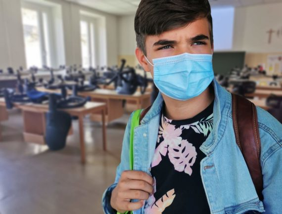 student wearing a mask during pandemic